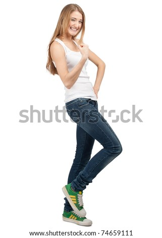 Full length portrait of happy excited girl celebrating her victory. Over white background - stock photo