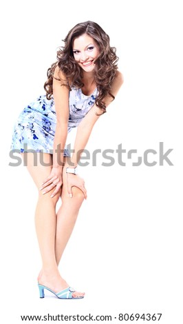 Full length portrait of happy excited girl jumping with arms extended . Over white background - stock photo