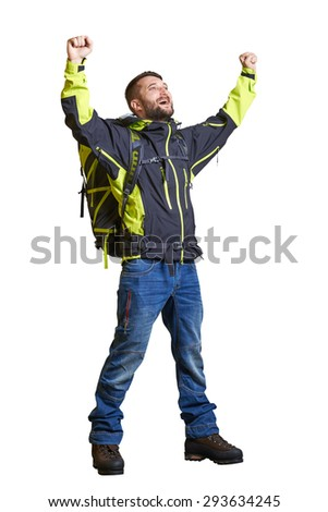 full length portrait of happy hiker with backpack raising his hands up and looking up. isolated on white background - stock photo