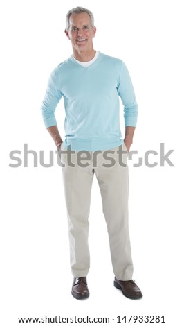 Full length portrait of happy mature man in smart casuals standing over white background - stock photo