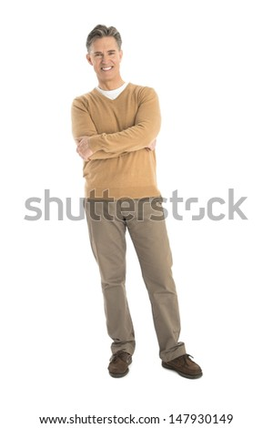 Full length portrait of happy mature man standing arms crossed isolated over white background - stock photo