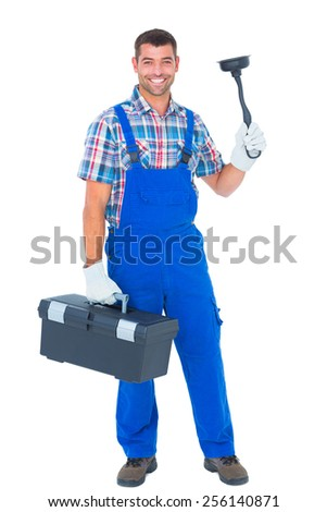 Full length portrait of happy plumber with plunger and toolbox on white background