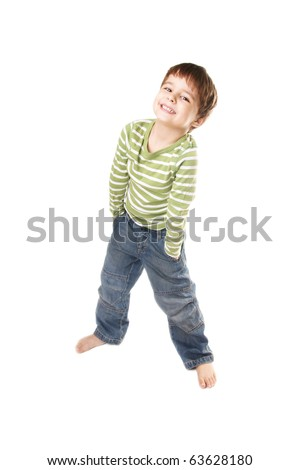 Full length portrait of happy smiling little boy in jeans on white background - stock photo