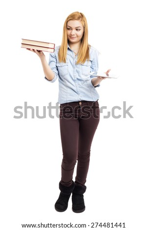 Full length portrait of happy teenage girl holding books in one hand and a tablet in other over white background - stock photo