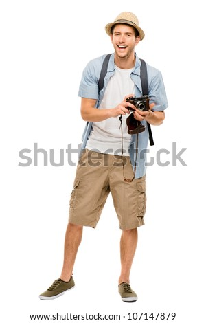 Full length portrait of happy tourist photographer man on white background - stock photo