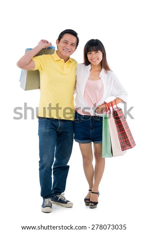 Full-length portrait of happy Vietnamese family with shopping bags