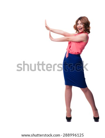 Full length portrait of happy woman making stop sign with palms isolated on a white background. Looking at camera - stock photo