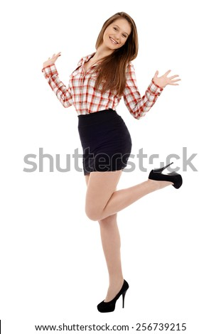 Full length portrait of happy young businesswoman isolated on white background - stock photo