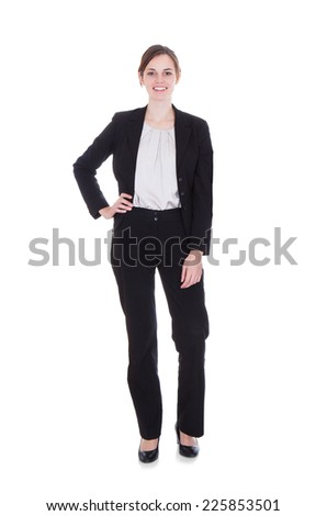 Full length portrait of happy young businesswoman standing over white background - stock photo