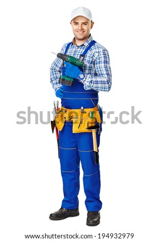 Full length portrait of happy young male construction worker with electric drill isolated on white background