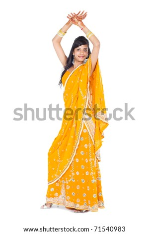 full length portrait of indian woman dancing in studio - stock photo