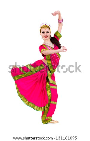 full length portrait of indian woman dancing in studio.  Isolated on white background. - stock photo
