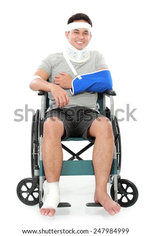 full length portrait of injured young man sit in wheelchair - stock photo