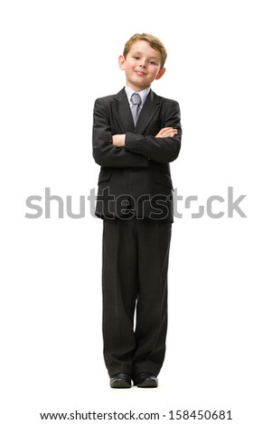 Full-length portrait of little businessman with his arms crossed, isolated on white. Concept of leadership and success - stock photo