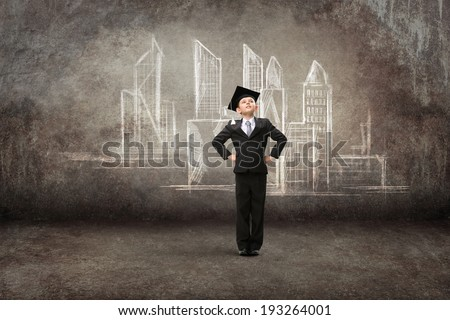 Full-length portrait of little student with hands on hips against city drawing. Concept of graduation and dreams - stock photo