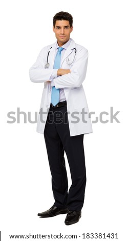 Full length portrait of male doctor standing arms crossed against white background. Vertical shot. - stock photo