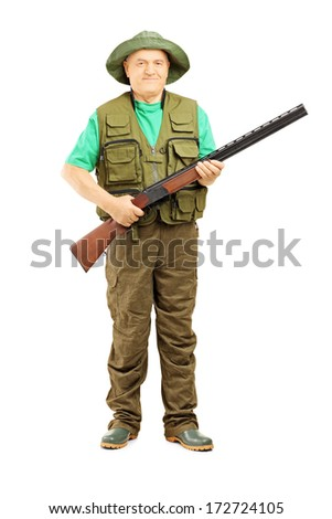 Full length portrait of male hunter holding a rifle isolated on white background