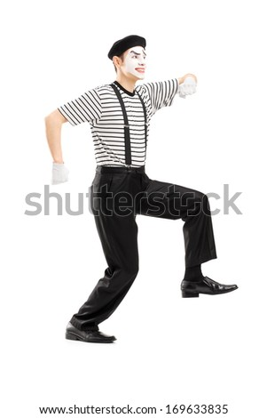 Full length portrait of male mime artist simulate walking on rope, isolated on white background - stock photo