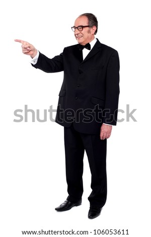 Full length portrait of male pointing at copy space - stock photo