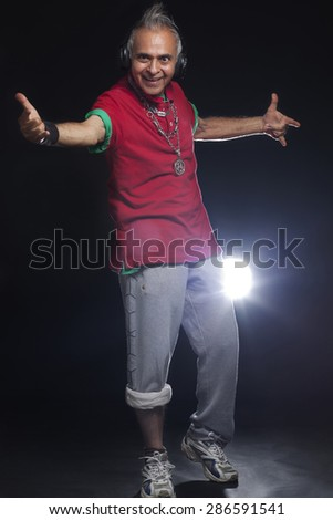 Full length portrait of man smiling while gesturing - stock photo