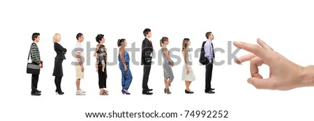 Full length portrait of men and women standing in a line with a hand about to push them isolated on white background - stock photo