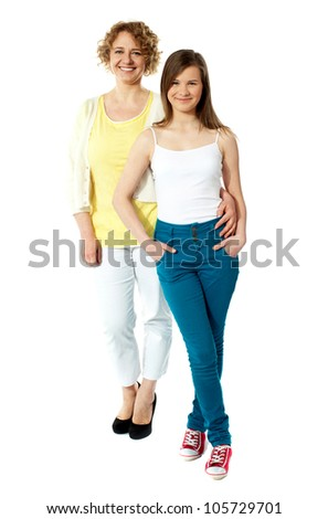 Full length portrait of mum and daughter isolated over white background