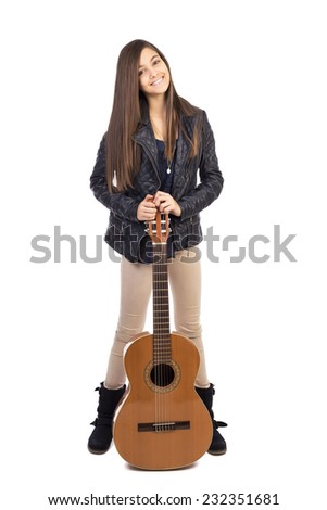 Full length portrait of pretty happy teenage girl with guitar against white background