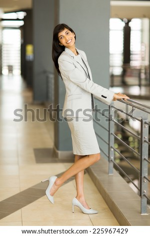 full length portrait of pretty indian business woman - stock photo