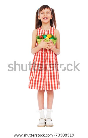 full-length portrait of pretty smiley girl with easter eggs - stock photo