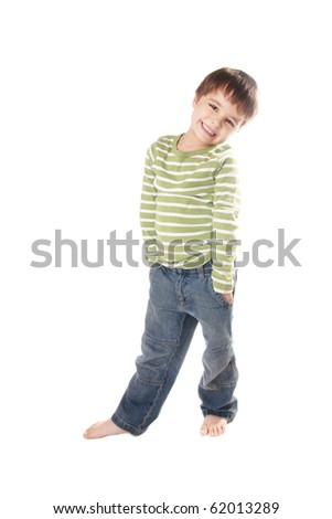 Full length portrait of pretty smiling little boy in jeans on white background - stock photo