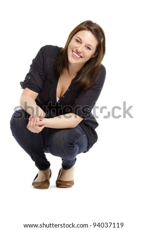 Full length portrait of pretty young woman sitting - Isolated on white background