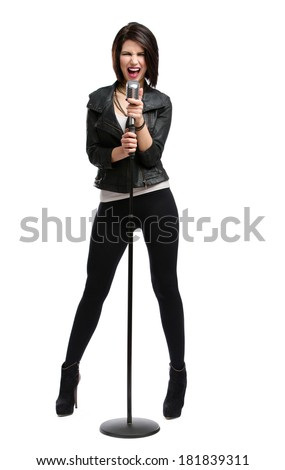 Full-length portrait of rock singer wearing leather jacket and keeping static mic, isolated on white. Concept of rock music and rave - stock photo