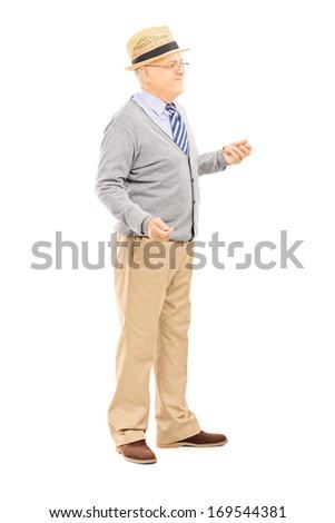 Full length portrait of senior man standing isolated on white background - stock photo