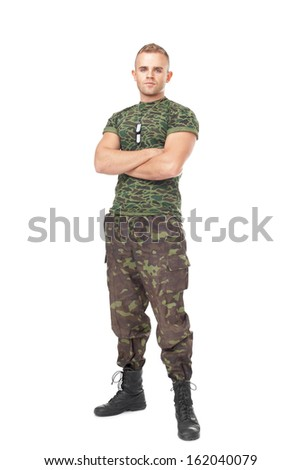 Full length portrait of serious army soldier with his arms crossed isolated on white background - stock photo
