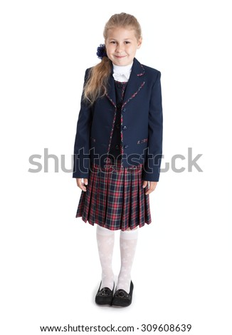 Full length portrait of seven years old pupil in school uniform, blond hair girl, isolated on white background