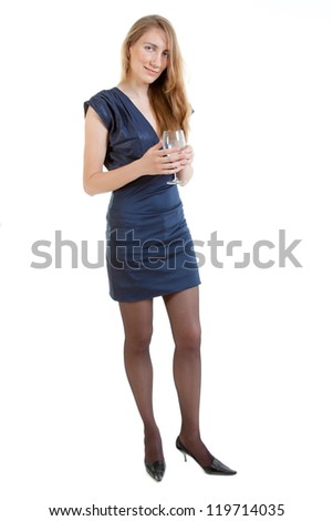 Full-length portrait of sexy young woman in a blue dress with a glass of water - stock photo