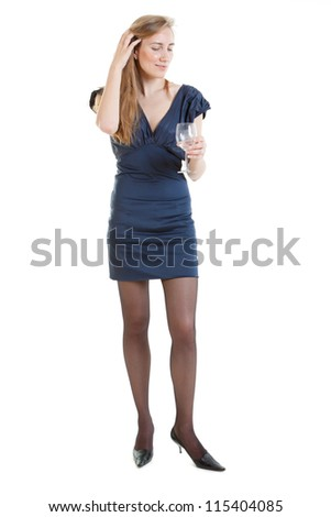 Full-length portrait of sexy young woman in a blue dress with glass of water - stock photo