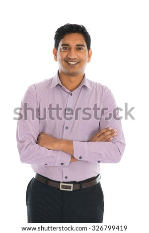 Full length portrait of smiling businessman standing arms crossed over white background. Vertical shot. - stock photo