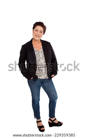 Full Length Portrait of Smiling Woman with Hands in Pockets Standing in Studio - stock photo