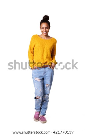 Full length portrait of stylish young woman standing on white background - stock photo