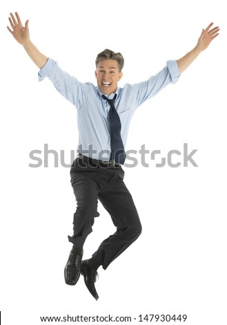 Full length portrait of successful mature businessman jumping in joy against white background - stock photo