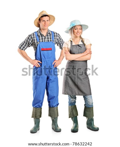 Full length portrait of two farmer posing isolated against white background - stock photo