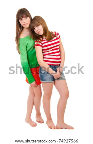 Full-length portrait of two girls, barefoot on a white background - stock photo