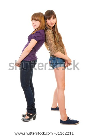 Full-length portrait of two girls, isolated on a white background - stock photo