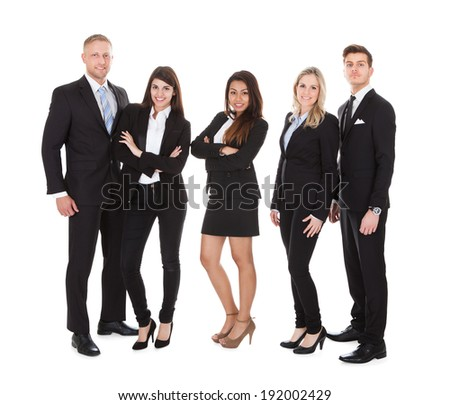 Full length portrait of welldressed businesspeople standing against white background