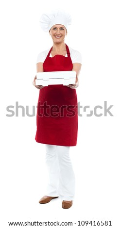 Full length portrait of woman chef offering hot fresh pizza packed well