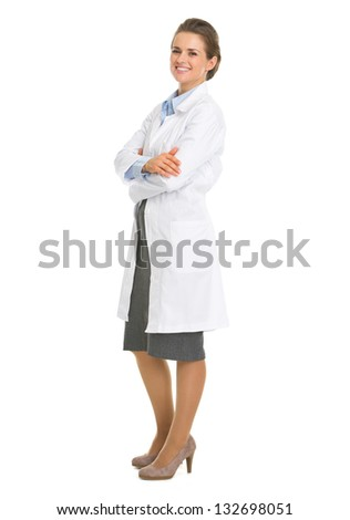 Full length portrait of woman in white robe - stock photo
