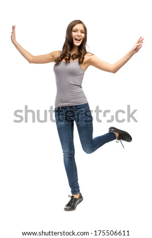 Full-length portrait of woman with hands up, isolated on white - stock photo