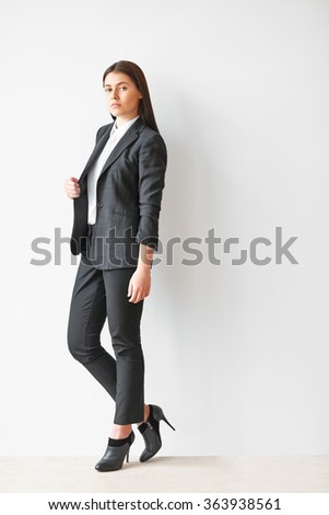 Full length portrait of young beautiful business woman - stock photo