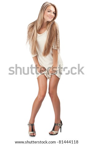 Full length portrait of young beautiful woman against white background - stock photo